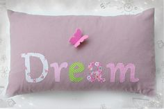 """Let your dreams fly like the small pink butterfly that lies down on that beautiful purple pillow LullabyGigi made for you. Decorate your bedroom, your living room or the kids room with it, to remind you all the dreams you had in the past and inspire you for all those that will come true into the future.  After all, """"Those who dream by day are cognizant of many things which escape those who dream only by night""""… Edgar Allan Poe"""