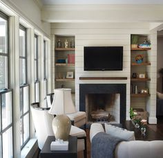 plank board detail on TV wall - eclectic family room by Clark & Zook Architects, LLC