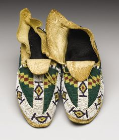 American Indian Art:Beadwork, A PAIR OF CHEYENNE BEADED HIDE MOCCASINS. . c. 1890. ... (Total: 2Items)