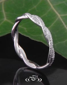 Custom 950 platinum twist style band to match with GLJW made engagement ring Bead set along top half of shank round brilliant cut melee diamonds.