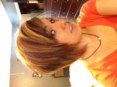 Angled short hair bob with red and brown highlights