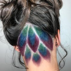 Peacock undercut + hair color by Tangerine Salon - Aveda