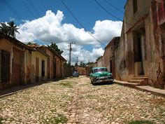 """It's easy to see why Trinidad has been called """"the museum city of Cuba."""" The meticulously preserved town offers a window into the past, from its sprawling colonial palaces and plazas to its remnants of sugar mills and slave barracks from another era."""