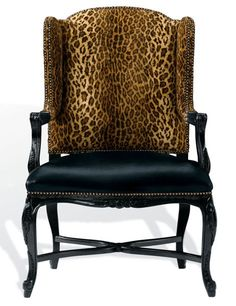"Spencer chair with nailhead trim, with European-beech frame available in a variety of finishes (shown here in black lacquer) and a choice of fabric, leather, or c.o.m. upholstery (pictured here in Buckmaster Ebony leather on seat, Aragon Leopard fabric on seat back), 45.5"" h. x 30"" w. x 27"" d., from $5,745."
