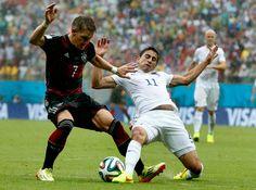 Alejandro Bedoya of U.S. challenges Bastian Schweinsteiger of Germany (June 26, 2014).