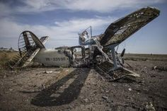 A burnt-out plane is seen at the destroyed airport in Luhansk, eastern Ukraine, September 14, 2014.  REUTERS/Marko Djurica