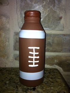I made this football noise maker using the screw top beer cans. I spray painted them and used electrical tape for the stripes and a white permanent maker to make the football lace. I also put the kids #'s on the other side and filled them with 5 pennies. They worked great!