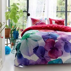 Floral bed cover with vibrant and joyful colors