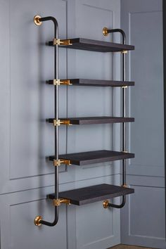 This single bay of our Loft Shelving is wall-mounted to support five shelves, using custom machined brass fittings on bent steel posts. Amuneal's proprietary machined hardware clamps onto the posts so that the shelves can be easily adjusted at any Loft Oak Shelves, Glass Shelves, Wall Mounted Shelves, Shelf Wall, Industrial Shelving, Industrial House, Pipe Shelving, Diy Pipe Shelves, Plumbing Pipe Shelves