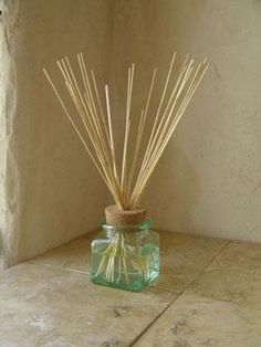 Save money by making your own essential oil diffuser out of recycled glass containers and reeds. #aromabotanical