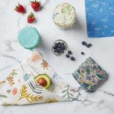 If you are trying to reduce how much single-use plastic wrap you use, opt for reusable beeswax food covers. These eco-friendly wraps are made from fabric coated in beeswax and each one will last up to a year. Plus, they're easy to make—no sewing required! Plastic Wrap, Plastic Bags, Plastic Spoons, Beeswax Food Wrap, Pinking Shears, Viking Tattoo Design, Sunflower Tattoo Design, Homemade Beauty Products, Glass Jars