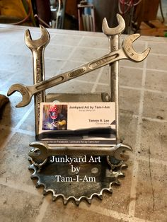 Junkyard Art by Tam-I-Am. Repurposed wrenches and a sprocket welded together to make a business card holder. Scrap metal art.