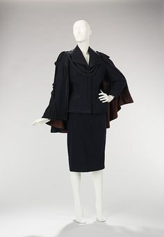 Suit House of Balmain  (French, founded 1945)  Designer:     Pierre Balmain (French, St. Jean de Maurienne 1914–1982 Paris) Date:     fall/winter 1949–50 Culture:     French Medium:     wool, silk