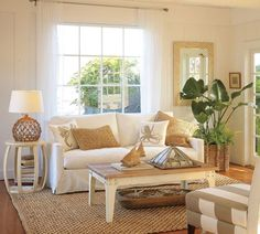 Coastal living room with nautical rope and glass lamps