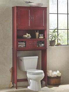 Rustic Space Saver by Country Door. Well-designed 2-door cabinet with an open shelf offers valuable space for your bathroom essentials. Rustic metal scrolling on drawer.