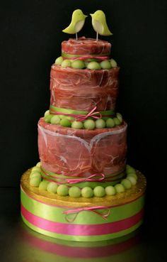 Meat Cake from Conjurer's Kitchen Facebook Page - Parma Ham, melon, and bread wedding 'cake', with apple love birds.