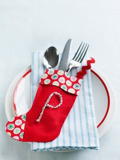 Mini-felt stockings are the perfect holders for utensils. Stack them on a tray if you're serving buffet-style, or put one at each place setting on the dining table. Personalize store-bought stockings by gluing fabric trim on the top and toe.