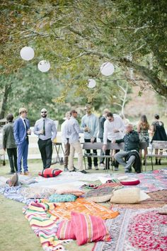 You could maybe have everyone sit on pretty blankets and rugs for a casual backyard wedding. Maybe provide seating for older relatives who would have trouble sitting on the ground? #BackyardWedding #BackyardWeddingIdeas
