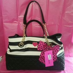 BETSEY JOHNSON SHOPPER STRIPE PURSE This is a brand-new Betsey Johnson purse from Macys. It has black and white stripes and polka dot pink bow on the front. It has pink interior with flowers and a zipper pouch in the middle to make two sides inside the purse. Brand new with tags retail value $108. Betsey Johnson Bags Totes