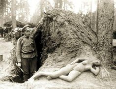 Scout Alekseev and his sculpture of a woman from moist sand, 1916
