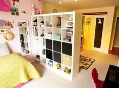 Design Solutions for Shared Kids Bedrooms...Expedit to the rescue. This mom calls the shelf room divider the best idea in the room. Phia uses her side to hold her belongings while Anthony's side has pegboard from which he hangs his toys