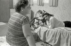 A young Elvis Presley at home in Memphis with his mom Gladys, circa 1956. Photo by Phillip Harrington for Look magazine.