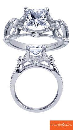 A beautiful Gabriel & Co. 14k White Gold Princess Cut Diamond Criss Cross Engagement Ring.