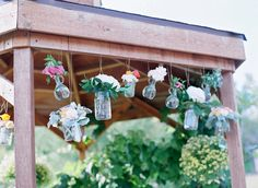 Hanging jars of flowers as ceremony decor | Laura Murray Photography | Bridal Musings