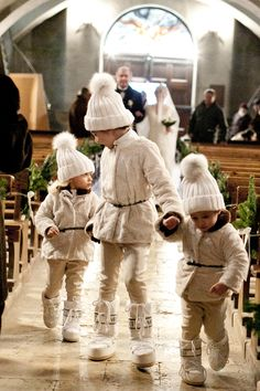 Oh my goodness. Your guests would melt at the sight of these adorable flower girls in snow attire for a winter wedding.