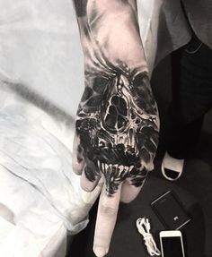 Horror tattoo skull hand