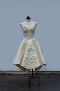 Dress made almost entirely out of masking tape by Esther, a 17 year old designer. This dress won a Gold Key at the Scholastic Art and Writing competition, for which it was made. Esther was inspired by architecture and an empty butterfly chrysalis.