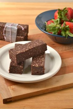 raw vegan chocolate cranberry bars - do not add extra berries at the end thinking you can't taste them because it's too chocolatey...the cocoa powder mellows out/soaks in once it sits in the fridge.