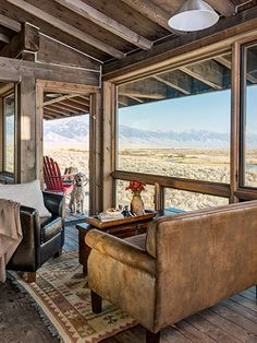 Cost Plus World Market bargains—a leather sofa and armchair, and a coffee table— furnish this living room. The kilim rug is from Catherine Lane Interiors in Livingston, Montana.