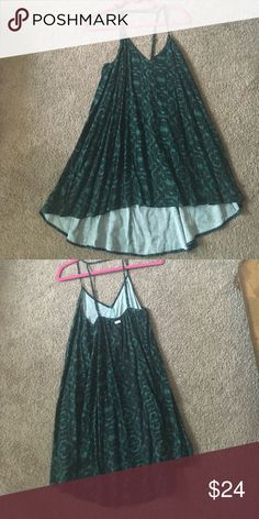 Assymetrical green patterned dress This strappy green assymetrical swing dress is very comfortable and flattering. Pair with wedges for a cute outfit for a night on the town. Dresses Asymmetrical