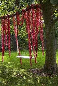 Take advantage of a backyard swing by wrapping garlands of carnations around a tree branch. The result: a tempting spot for guests to gather and pose for pictures.