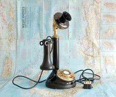 Beautiful Antique Candlestick Telephone - Black and Gold Rotary Phone. $125.00, via Etsy.