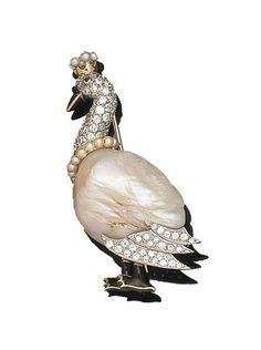 A pearl, ruby, enamel and diamond swan brooch x