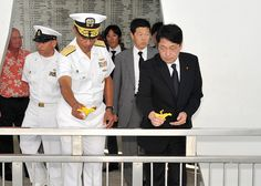 PEARL HARBOR (July 2, 2013) Adm. Cecil D. Haney, commander of U.S. Pacific Fleet, and Japanese Defense Minister Itsunori Onodera throw flowers into the wish well after a wreath laying ceremony aboard the USS Arizona Memorial to honor those that lost their lives during the attack of Pearl Harbor on Dec. 7, 1941.  (U.S. Navy photo by Mass Communication Specialist 2nd Class David Kolmel/Released)