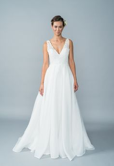 ea74a573df9b Exquisite, affordable wedding dress by Lis Simon available at Little White Dress  Bridal Shop in