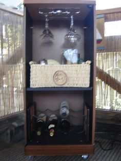 repurposed a 1980's stacked stereo cabinet into a mini bar for my screen house...not such a great photo, but enough to get the idea!!!