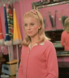 The Umbrellas of Cherbourg was directed by Jacques Demy, starring Catherine Deneuve and Nino Castelnuovo. The music was written by Michel Legrand Catherine Deneuve, Umbrellas Of Cherbourg, Michel Legrand, Jacques Demy, Romantic Films, Vogue, I Believe In Pink, Girls Sweaters, Cardigans