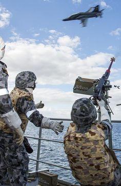Close quarters ... The crew of HMAS Arunta conduct a simulated 50 cal machine gun firing