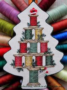 """The holiday, which is always with me.: Подвеска (Pinkeep) """"Christmas Spool Tree""""/ Sue Hi. Cross Stitch Christmas Ornaments, Xmas Cross Stitch, Cross Stitch Alphabet, Christmas Cross, Cross Stitch Charts, Cross Stitch Designs, Cross Stitching, Cross Stitch Embroidery, Cross Stitch Patterns"""