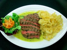 Tagliata con salsa Steak e cipolle fritte - Steak with Steak sauce and fried onions  Steak Restaurant
