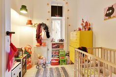 the boo and the boy: Eclectic kids' rooms. Like the yellow chest of drawers; mix of high & low; task lighting.