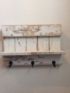 This shelf is repurposed out of old fence pickets. Use it to display pictures, candles and other knick knacks. Hang hats, dog leashes, and other items for easy access. The shelf is 17 1/2 inches wide by 12 inches tall and the shelf is 3 1/2 inches deep.