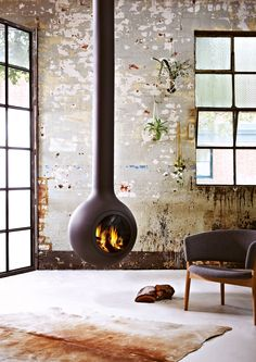 Bathyscafocus Hublot slow combustion suspended fireplace brings together the ancient element of fire and the power of the sea for spectacular design outcome.