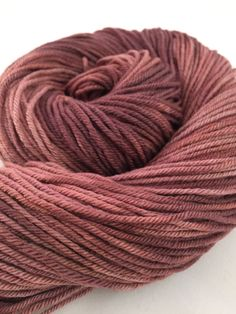A lovey, warm brown with purple and pink undertones dyed on non-superwash merino worsted weight yarn. These are the only four skeins of this