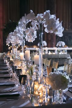 Mirror Runner with Candles & White Florals | Photography: Brett Matthews Photography. Read More: http://www.insideweddings.com/weddings/classic-greek-orthodox-ceremony-modern-reception-in-new-york-city/702/
