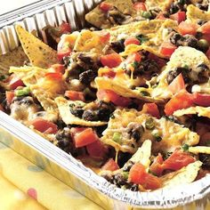 Picnic taco nachos - yes!  Easy to make at a picnic or camping, but also yummy to make at home with a full size baking pan.